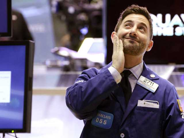 In this Tuesday, Dec. 11, 2012 file photo, specialist Christian Sanfilippo works on the floor of the New York Stock Exchange