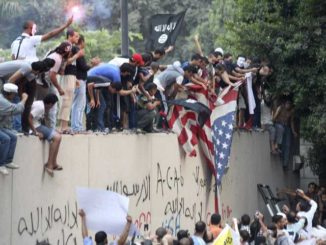 In this Sept. 11 photo, protesters destroy an American flag pulled down from the U.S. embassy in Cairo, Egypt, during a protest of a film deemed offensive of Islam.