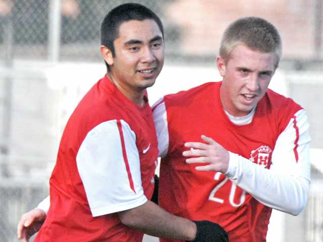 Hart players Osmar Martinez, left and Riley Waldeck (20) celebrate Martinez's goal against Canyon on Friday at Hart High.