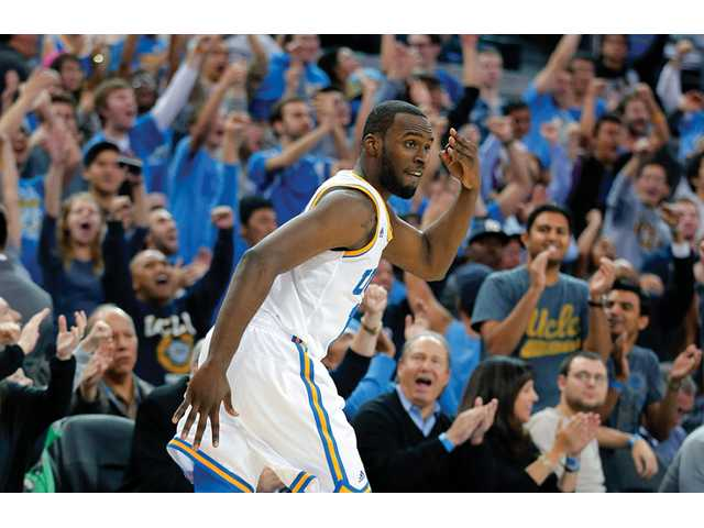 UCLA's Shabazz Muhammad reacts after making a 3-pointer against Missouri in Los Angeles on Friday.