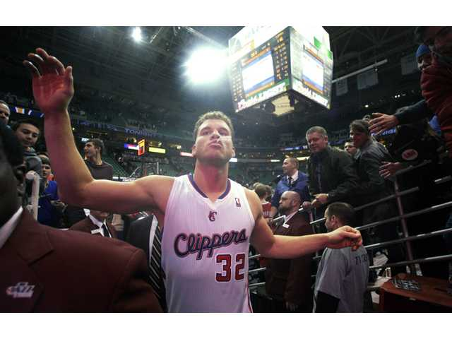 Los Angeles Clippers power forward Blake Griffin walks off the court after the Clippers' victory over the Utah Jazz on Friday in Salt Lake City.
