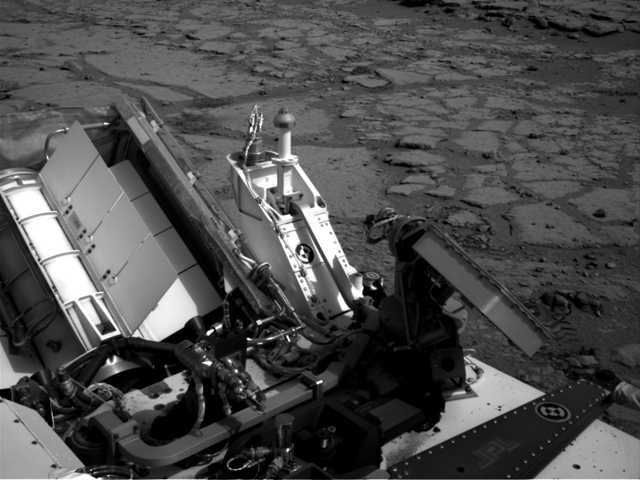 "This Dec. 12, 2012 file image provided by NASA shows the Mars rover Curiosity at a pit stop, a shallow depression called ""Yellowknife Bay."" Curiosity will now head for Mount Sharp in mid-February after it drills into its first rock."