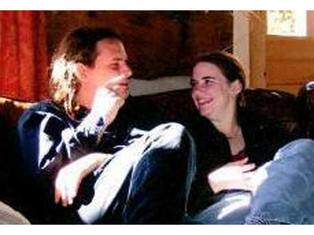 In this undated photo, Caitlan Coleman, right, sits with her husband, Josh.