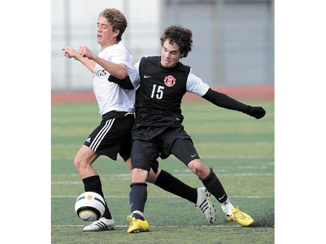 Valencia's Colton Morgan, left, and Hart's David White, right, battle for the ball on Saturday at Hart High School.