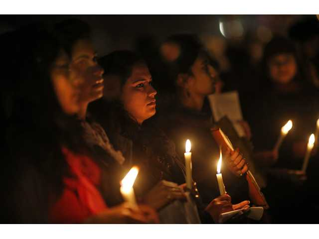 Indians hold a candle light vigil to salute the undying spirit of a rape victim and to mourn her death in New Delhi.