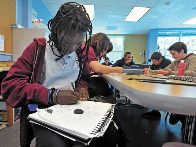 Ninth-grader Emily Ongele, 14, works on a two-point perspective drawing in an art class at the Albert Einstein Academy in Valencia.