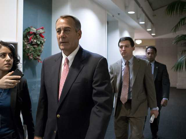 Speaker of the House John Boehner, R-Ohio, walks to a closed-door GOP caucus.