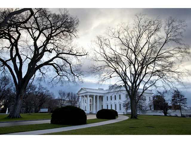 Clouds roll over the White House in Washington on the morning of Sunday.