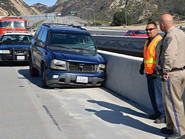 Three people were transported from the scene of a crash Monday on the Highway 14 freeway in Newhall Pass. Photo by Rick McClure