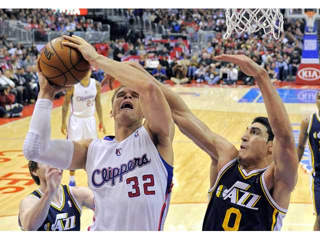 Los Angeles Clippers forward Blake Griffin, left, goes up for a shot against the Utah Jazz on Sunday in Los Angeles.