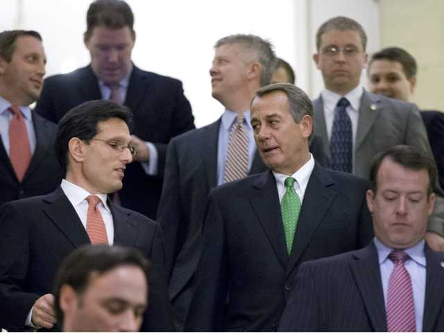 "Speaker of the House John Boehner, R-Ohio, center right, and House Majority Leader Eric Cantor, R-Va., center left, walk to discuss the ""fiscal cliff"" bill, which was passed by the Senate Monday night, at the Capitol in Washington, on Tuesday."