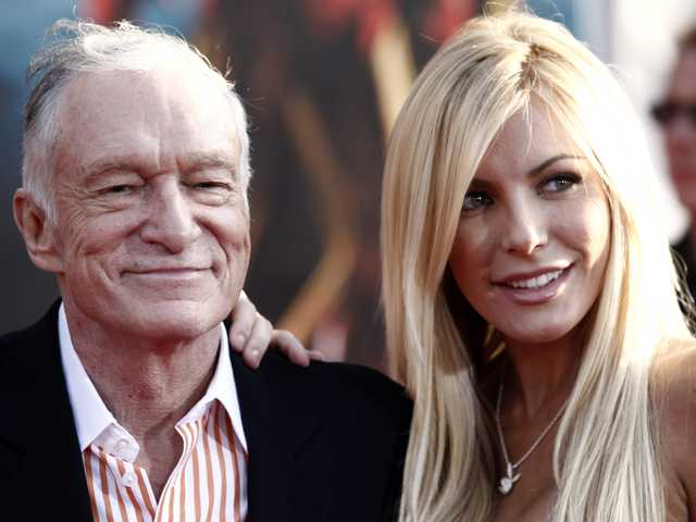 "In this April 26, 2010 file photo, Hugh Hefner, left, and Crystal Harris arrives at the premiere of ""Iron Man 2"" at the El Capitan Theatre in Los Angeles."
