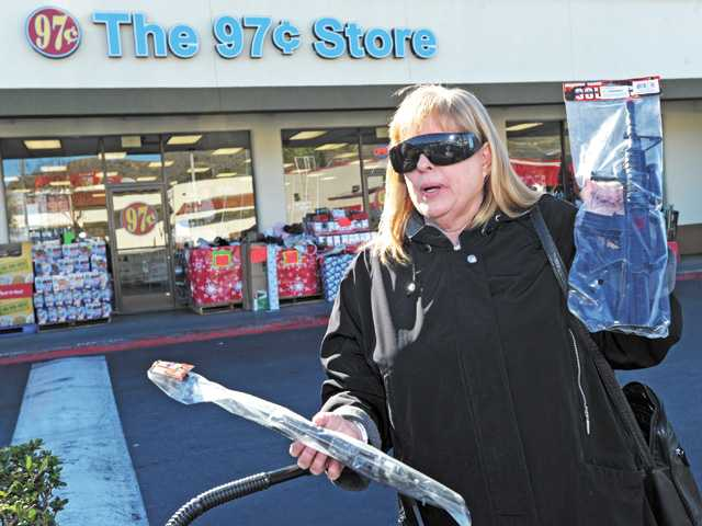 Jennifer Roa displays some of the toy guns she purchased outside The 97 cent Store in Canyon Country on Friday.