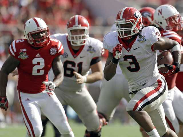 Georgia running back Todd Gurley (3) runs for a 24-yard touchdown past the Nebraska defense during the first half of the Capital One Bowl on Tuesday in Orlando, Fla.