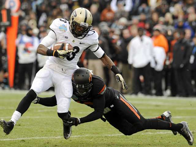 College football: Oklahoma St rolls Purdue in Heart of Dallas Bowl