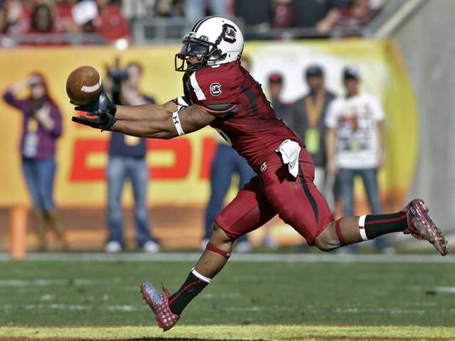 South Carolina wide receiver Nick Jones pulls in a pass during the first quarter of the Outback Bowl against Michigan on Tuesday in Tampa, Fla.