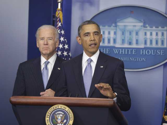 President Barack Obama and Vice President Joe Biden makes a statement regarding the passage of the fiscal cliff bill in the Brady Press Briefing Room at the White House in Washington, Tuesday.