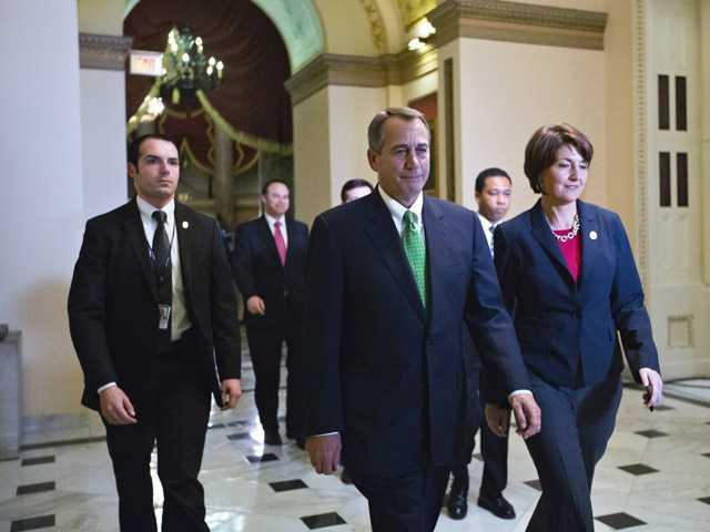 Speaker of the House John Boehner, R-Ohio, and Rep. Cathy McMorris Rodgers, R-Wash., right, arrive at the House of Representatives.