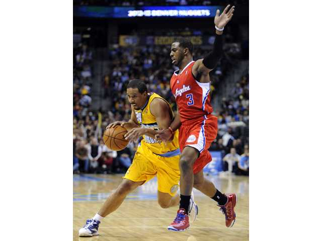 Denver Nuggets guard Andre Miller (24) drives past Los Angeles Clippers guard Chris Paul (3) on Tuesday in Denver.