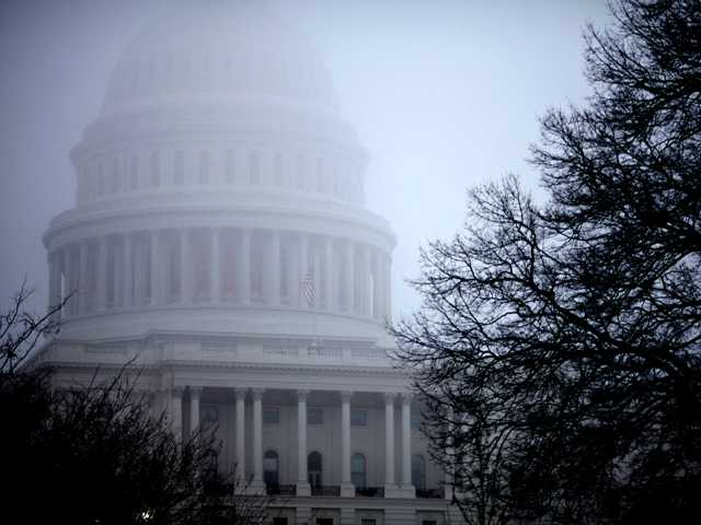 Fog obscures the Capitol dome on Capitol Hill in Washington on Dec. 10, 2012. Billions of dollars in tax breaks for businesses were tucked into the fiscal cliff budget deal.