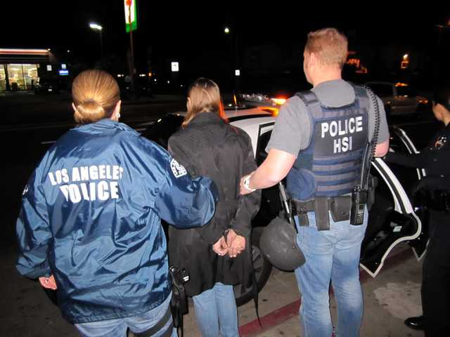 In this image provided by U.S. Immigration and Customs Enforcement, Letha Mae Montemayor, is arrested on suspicion of child pornography charges, Thursday in Los Angeles.