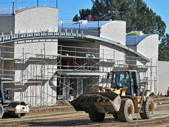 A construction crew continues work Friday on the Castaic Regional Sports Complex Aquatic Center project. The three-pool complex is due to open in June. Signal photo by Jonathan Pobre