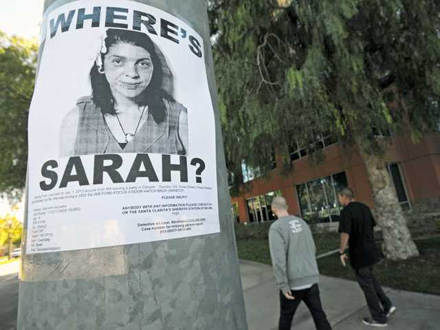 "A ""missing"" poster describing 19-year-old Sarah Alarid is posted near Westfield Valencia Town Center on Friday. Signal photo by Jonathan Pobre"