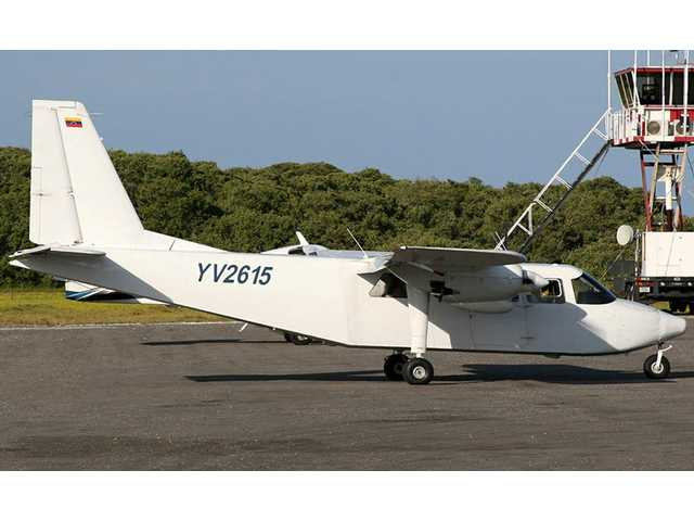 A plane that went missing sits on the tarmac of the airport in Los Roques, Venezuela.