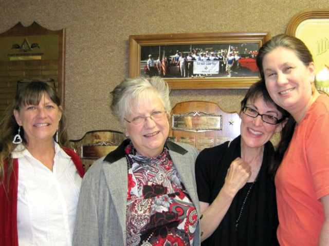 From left, Dessie Bauer, Mary Douglas, Rev. Tina Fox and Rebecca Warkentin pausing for a photo after Sunday service at the Masonic Temple, shortly before the move to the new location on Dolan Way.