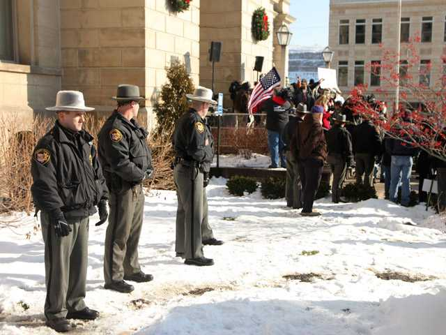 Jefferson Co. sheriff's deputies stand nearby during the protest at the Jefferson County Courthouse in Steubenville, Ohio.