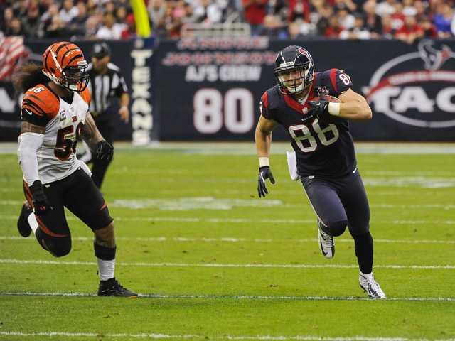 Houston Texans' Garrett Graham (88) runs by Cincinnati Bengals' Rey Maualuga (58) during the second quarter of an NFL wild card on Saturday in Houston.