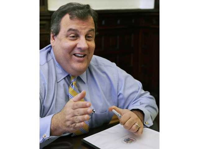 New Jersey Gov. Chris Christie smiles as he answers a question during an interview in his office at the Statehouse in Trenton, N.J.