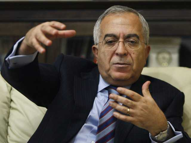 Palestinian Prime Minister Salam Fayyad gestures during an interview with The Associated Press in the West Bank.