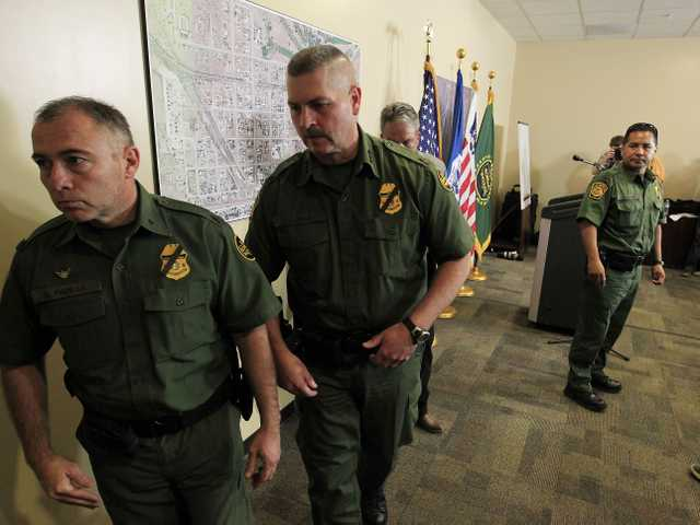 U.S. Border Patrol agents from the Tucson Sector, and Jeffrey Self, U.S. BorderProtection Joint Field Command Arizona, leave the U.S. Customs and Border ProtectionBorder Patrol Station on Oct. 2, 2012, in Bisbee, Ariz.