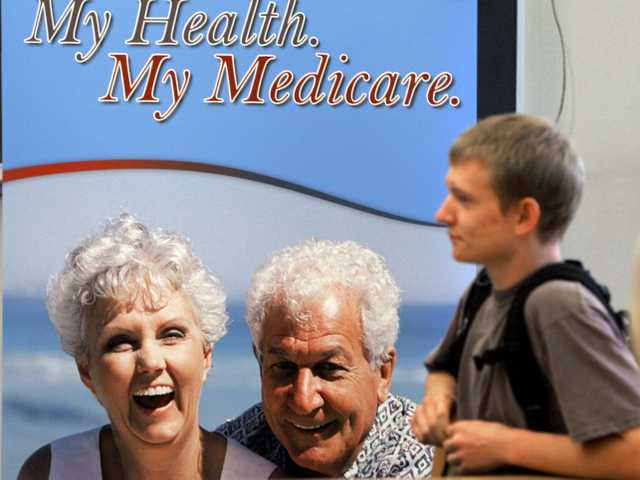 A poster promoting a Medicare assistance program sits behind a student at Montpelier High School in Montpelier, Vt., Wednesday, Sept. 20, 2006.