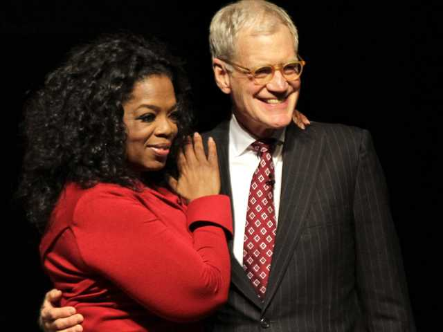 "This Nov. 26, 2012 file photo shows Ball State University alumnus David Letterman, right, host of CBS's ""Late Show,"" with Oprah Winfrey."