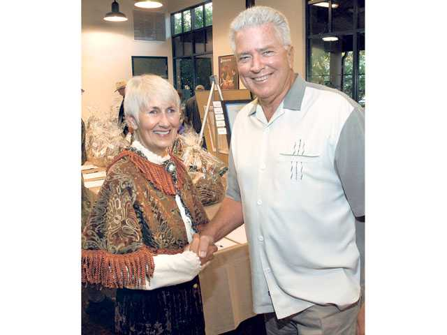 In this Aug. 8, 2009, file photo, city councilwoman Laurene Weste meets television personality Huell Howser at the Silents Under the Stars fundraiser at Hart Hall in Newhall. (Signal File Photo)