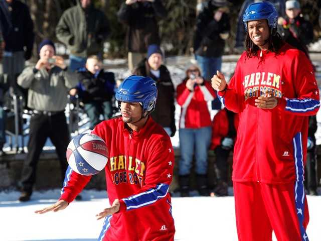 Fans watch the Harlem Globetrotters on ice at Millennium Park on Monday, Jan. 7, 2013, in Portage, Mich.