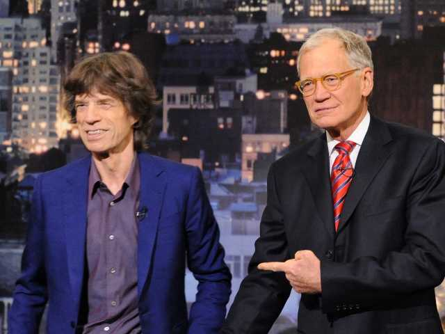 "Rolling Stones frontman, Mick Jagger, left, greets host David Letterman on the set of the ""Late Show with David Letterman,"" Tuesday, Dec. 11 in New York."