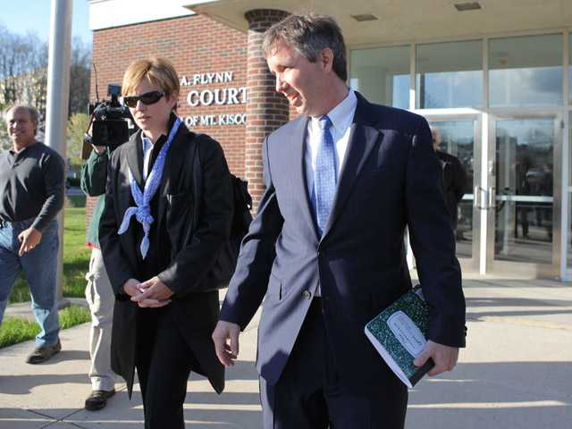 In this 2012 photo, Douglas Kennedy, right, arrives at village court in Mount Kisco, N.Y.