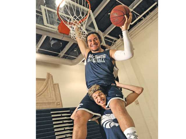 West Ranch senior Ako Kaluna, a 6-foot-7-inch, 275-pound forward/center, and 6-foot-1-inch lanky guard Kevin Harris were each All-Santa Clarita Valley first-teamers in 2012. They are a major reason why West Ranch is a Foothill title favorite in 2013.