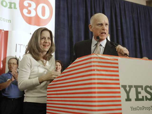 In this 2012 photo, Gov. Jerry Brown and his wife, Anne Gust Brown thank supporters for their work on Proposition 30.