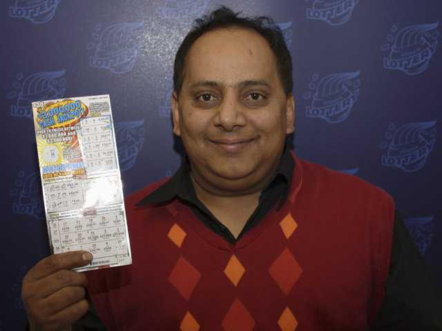 This undated photo provided by the Illinois Lottery shows Urooj Khan, 46.
