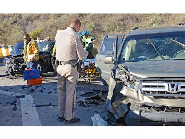 A woman suffered a serious leg injury after the vehicle she was driving struck another car on The Old Road at Weldon Canyon Road Tuesday afternoon. (Rick McClure/For The Signal)