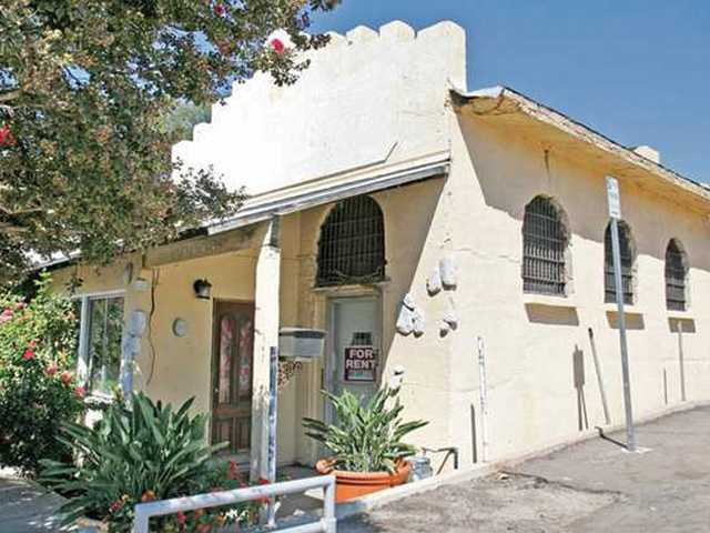 "The old Newhall Jail on Spruce Street is one of several sites considered for a historic-landmark designation. On Tuesday night City Council approved language for an ""opt in"" ordinance that gives most property owners the choice on whether they want to seek historical designation for their properties."