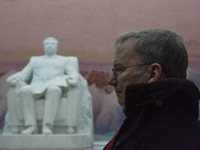 Executive Chairman of Google, Eric Schmidt stands near a statue of the late North Korean leader Kim Il Sung.