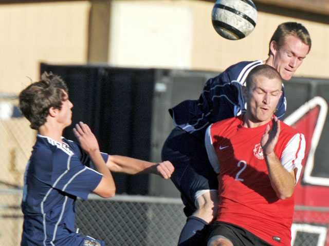 From left, West Ranch's Eduardo Trujillo and Wade McMillon collide with Hart's Jonathan Rose on Tuesday at Hart High.