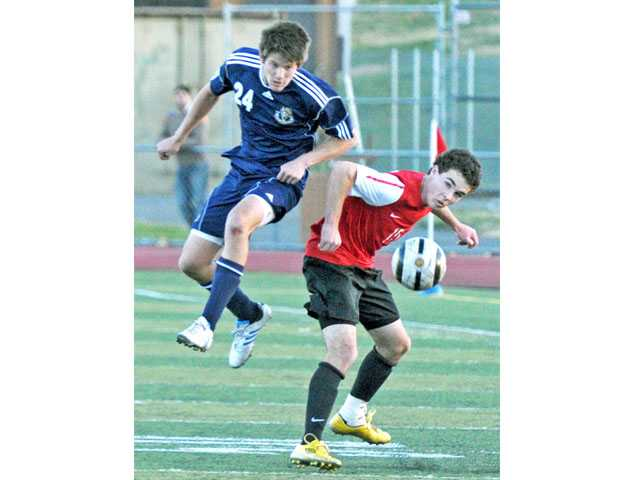 West Ranch's Zackary Sage, left, and Hart's David White jockey for possession on Tuesday at Hart High.