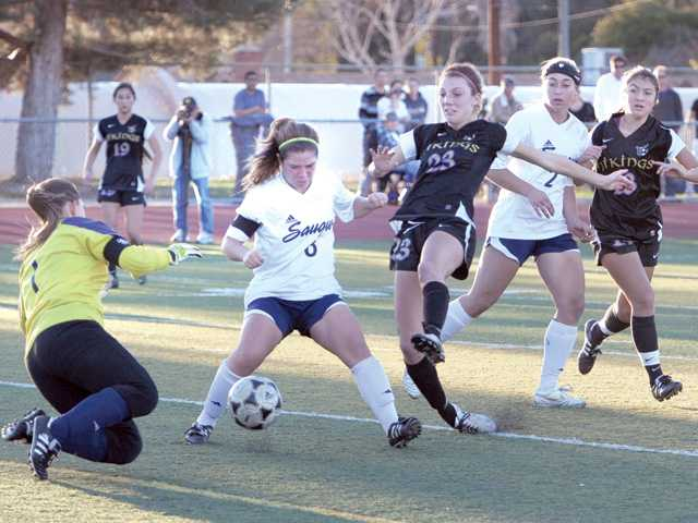 Saugus goalkeeper Maddie Hebert, left, gets help from teammate Alexandria Pico (8) on Tuesday at Saugus High.