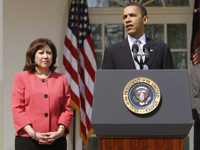 This 2010 file photo shows Labor Secretary Hilda Solis standing with President Barack Obama in the Rose Garden of the White House.